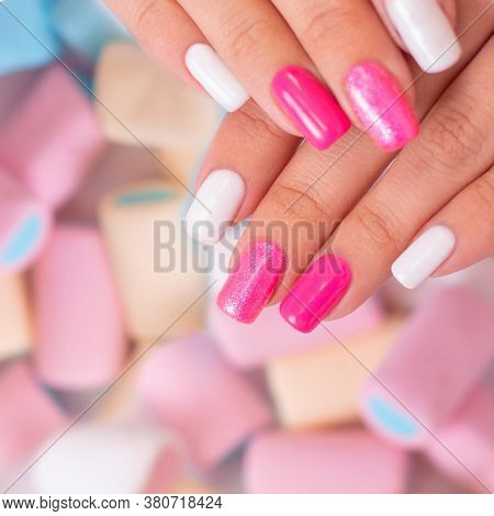 Close Up View Of Beautiful Female Hands With Multicoloured Manicure Nails, Pink And White Gel Polish