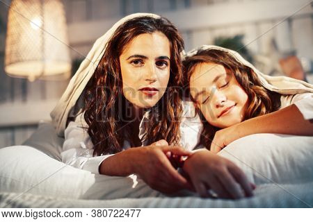 Young Pretty Girls In Bed At Christmass Morning, Happy Family Smiling Lifestyle At Holiday