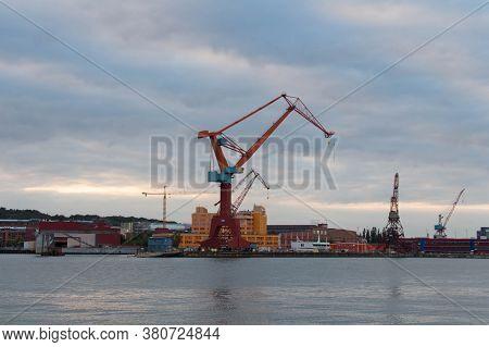 Gothenburg, Sweden - June 17 2019: The View Of Cranes In Gothenburg Harbour At Sunset Light On June