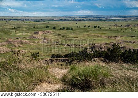 Distant View Of Badlands Rock Formations And Praire Plains Of Badlands National Park In South Dakota