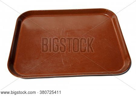 TV Tray. A brown plastic Delicatessen or TV tray to hold and transport Food and other items. Isolated on white. Room for text. Plastic Trays are used world wide for many reasons.