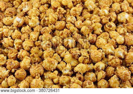 Delicious Candy Caramel Covered Popcorn Close Up Snack Food Background