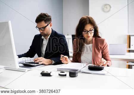 Business Accountant People Doing Tax Audit And Accounting Using Calculator