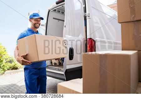 Truck Mover Unloading Van Carrying Boxes And Moving House