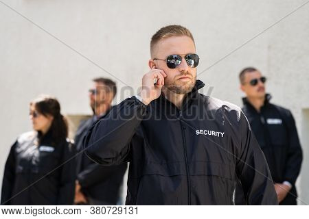 Security Guard Event Service. Officer And His Group