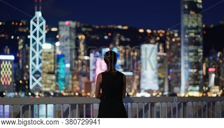 Woman look at the city in the evening