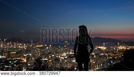 Woman enjoy the city view under sunset