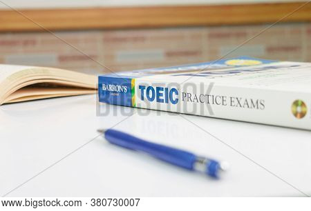 Nakhon Ratchasima, Thailand- August 9, 2020: Barron's Toeic Book On White Table With Textbook And Pe