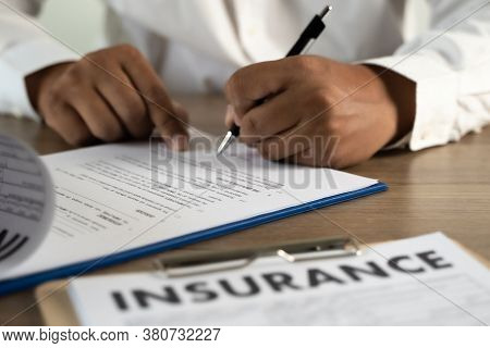 Concept Of Insurance Man Protective And Car  Family  Health Insurance  Policy Examining