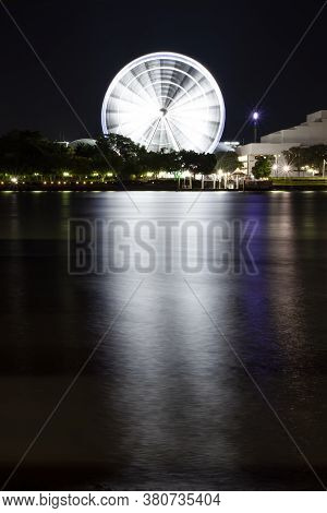 Nightscape View Of Brisbane City With Famous Ferris Wheel