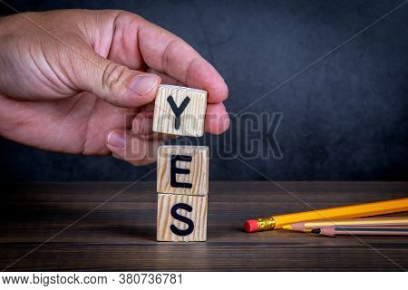 Yes. Approval, Support And Consent Concept. Wooden Alphabet Letters And Pencils