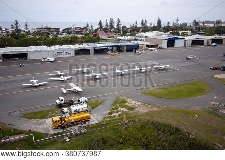 Queensland, Australia - December 20, 2007: Airport With Docks And Parked Small Motor Airplanes