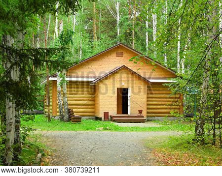 Wooden House In The Forest For Relaxation.\nsmall Resort Wooden House.\nwooden Hut In A Pine Forest.