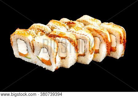 Isolated Unagi Sushi Rolls With Salmon On The Black Background