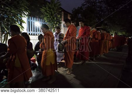 Luang Prabang, Laos - 15 January 2019 - Laos Buddhist Alms Giving Sticky Rice Ceremony In The Mornin