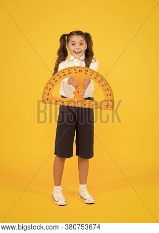 Engineering Course. Geometry Concept. Schoolgirl Holding Protractor For Lesson. Little Child Prepari