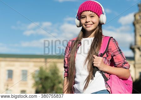 Feel The Sound. Happy Kid Listen To Music Urban Outdoors. Hi-fi Stereo Sound. New Technology. Modern