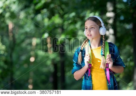 Listening And Learning. Small Kid Listen To Music Natural Outdoors. Listening Comprehension. English