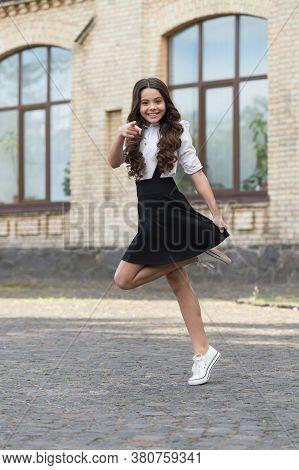 Do You Have A Uniform. Energetic Child Point Finger Outdoors. School Fashion. Fall Uniform Trend. Un