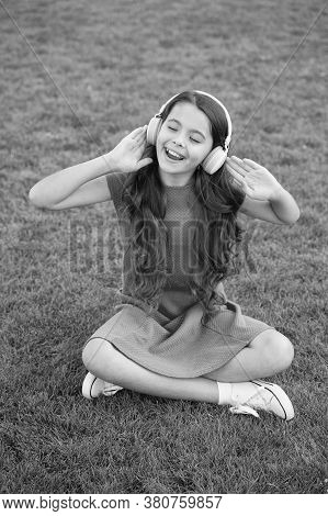 Practicing Her Singing. Happy Singer Sing Song Outdoors. Little Girl Enjoy Singing To Music. Vocal E