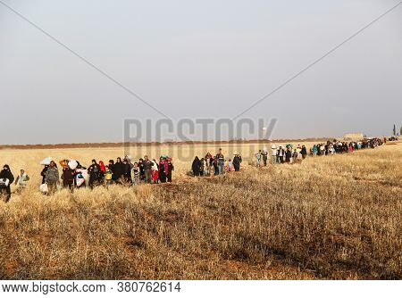 Aleppo, Syria 11 March 2017:\nlarge Groups Of Civilians Walk Between The Fields To Escape The Bombin