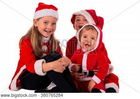 3 Young Children, 2 Boys (1 Year Old - 4 Year Old) 1 Girl (6 Years Old) Sitting Together On The Floo