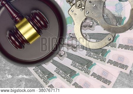 1000 Russian Rubles Bills And Judge Hammer With Police Handcuffs On Court Desk. Concept Of Judicial