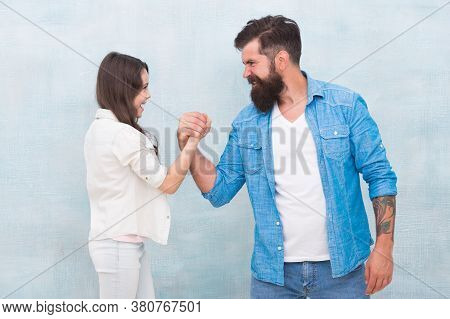 Open Competition. Father And Daughter Arm Wrestling. Strength Comparison. Force And Power. Conflict