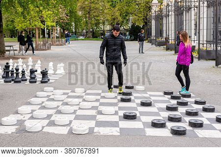 Geneva, Switzerland - April 16, 2019: People Playing Traditional Oversized Street Checkers Game In P