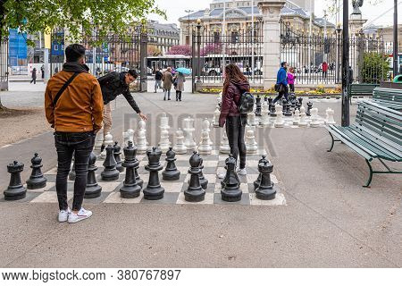 Geneva, Switzerland - April 16, 2019: People Playing Traditional Oversized Street Chess In Parc Des