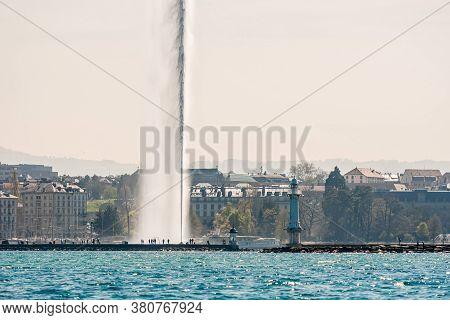 Geneva, Switzerland - April 15, 2019: Lake Of Geneva With Its Jet D.eau Or Large Fountain Spraying O