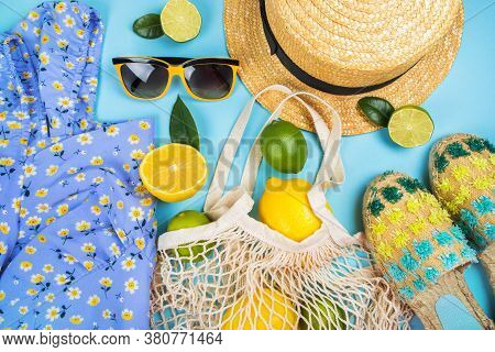 Summer Fashion Flatlay With Printed Dress, Straw Boater Hat, Espadrilles Sandals, Sunglasses And Str