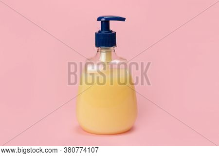 Bottle Of Liquid Soap In Yellow On A Pink Background. Clean Hands Concept. Shampoo, Liquid Soap, Aro