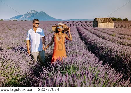 Couple Men And Woman On Vacation At The Provence Lavender Fields, Provence, Lavender Field France, V