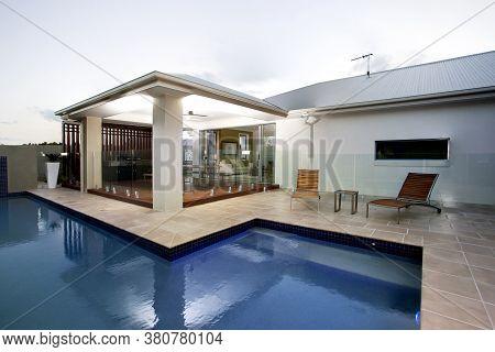 A Large Swimming Pool At House Backyard