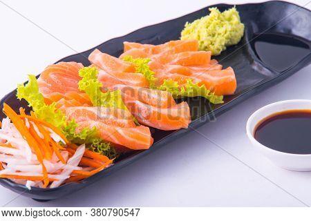 Salmon Sashimi On Black Dish At Restuarant