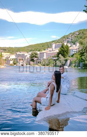 Couple On Vacation In Ardeche France, View Of The Village Of Vogue In Ardeche. France