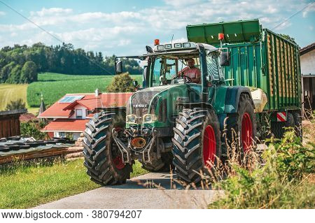 Bavaria/ Germany - August 07,2020: Fendt Favorit 926 Vario Tractor Drives With A Krone Zx400gl Trail