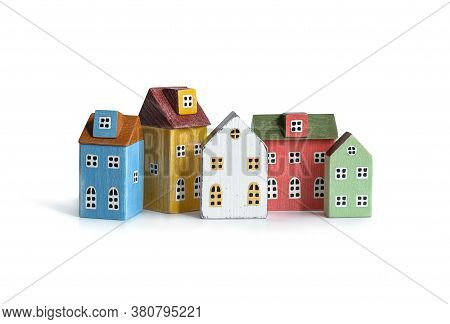 Wood Miniature Multicolor Houses Isolated On White. Real Estate, Insurance Concept, Mortgage, Buy Se