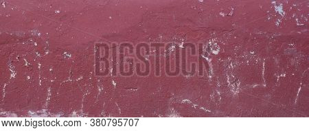 Background Texture Of The Wall With Old Maroon Plaster That Has Cracked