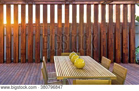 Wooden Table And Chairs At Outdoor Patio