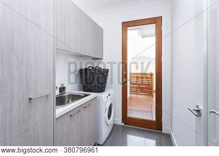 A Modern Laundry Room In Luxury House