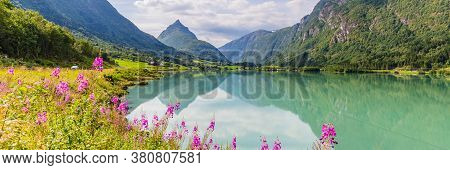 Mountain Panorama With Mountain Eggenipa Reflecting In A Lake In Gloppen Along Highway E39 In Sogn O