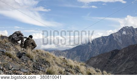 Hunting Ibex In The Mountains Determine Trophy Quality Animals Through Binoculars And A Telescope.