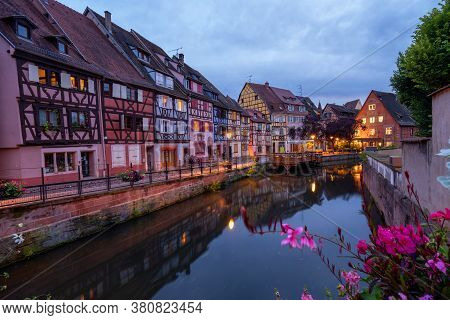 Colmar, Alsace, France. Petite Venice, Water Canal And Traditional Half Timbered Houses. Colmar Is A