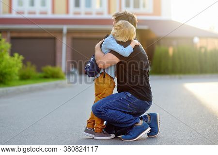 Little Boy Says Goodbye And Hugging To His Father Before Going To School. Education For Children. Fi