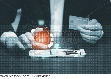 Businessman Hacker Is Using A Hand Typing Keyboard And Uses A Modern Credit Card By Laptop Screen Ha