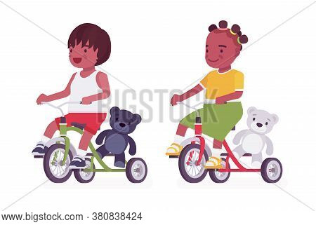 Toddler Children, Black Little Boy And Girl Enjoying Riding Tricycle. Cute Sweet Happy Healthy Baby