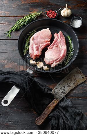 Raw Pork Steak On The Bone In Frying Grill Pan With Butcher Knife Or Cleaver And Ingedients For Gril