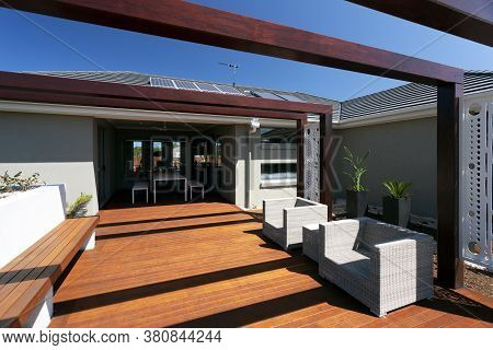 A Lounge Space At Backyard Of Modern House